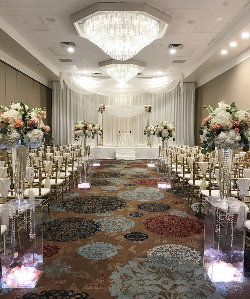 The Florida Hotel and Conference Center - long ceremony room with gorgeous chandeliers