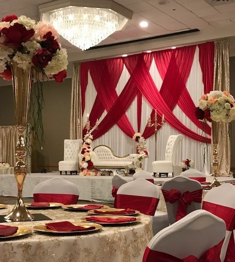 The Florida Hotel and Conference Center - sweetheart table on stage with red curtain backdrop