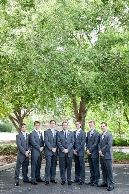 The-Villages-Polo-Club-Groomsmen standing outside with arms crossed in front of them