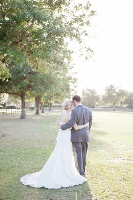 The-Villages-Polo-Club-Back of Bride and Groom with arms wrapped around each other