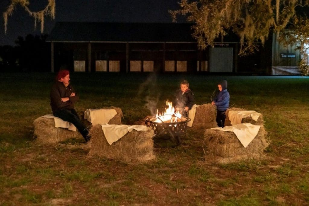 The-Villages-Polo-Club-Haystack seating surrounding a bonfire at night