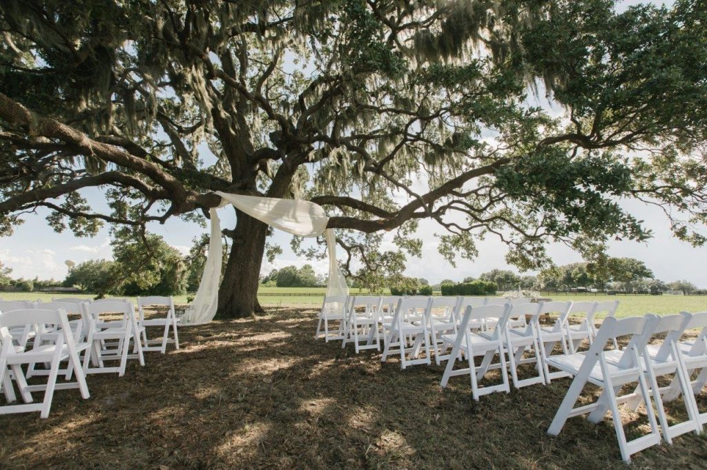 Villages Polo Club - Simple white touches turn a field into a wedding venue.