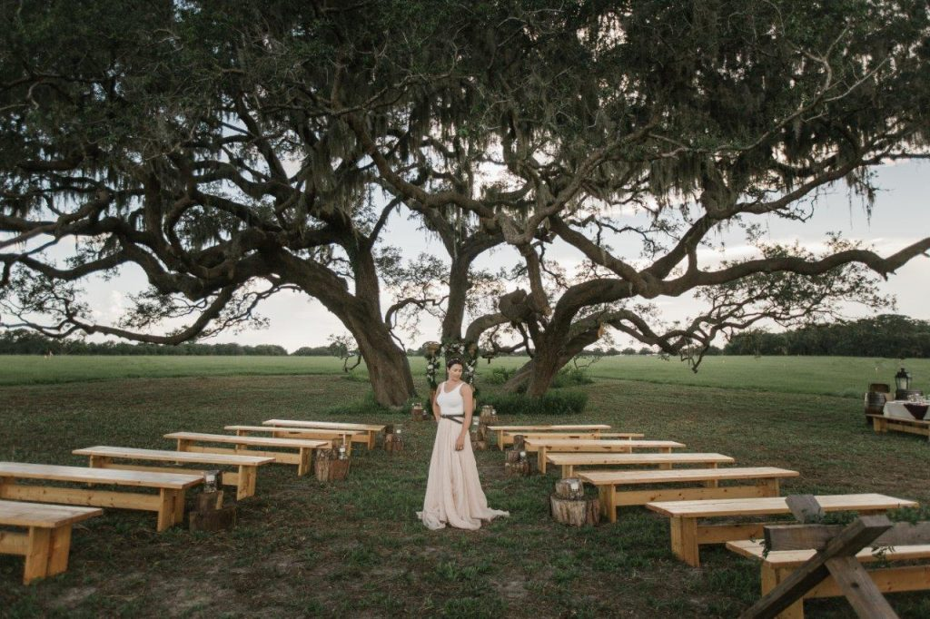 Villages Polo Club - rustic bench seating at ceremony