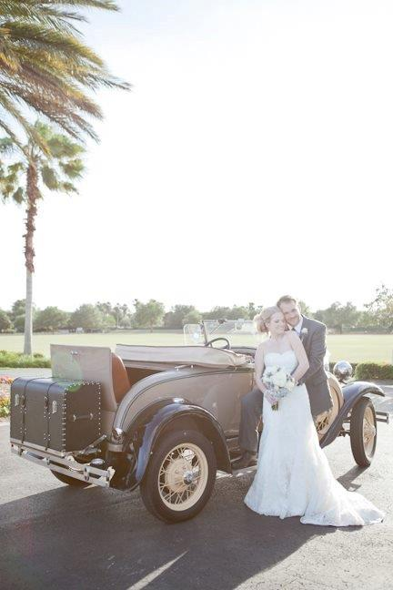 Villages Polo Club - couple poses with vintage car