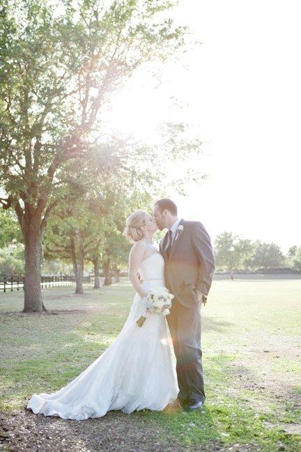 Villages Polo Club - bride and groom in sun-drenched field