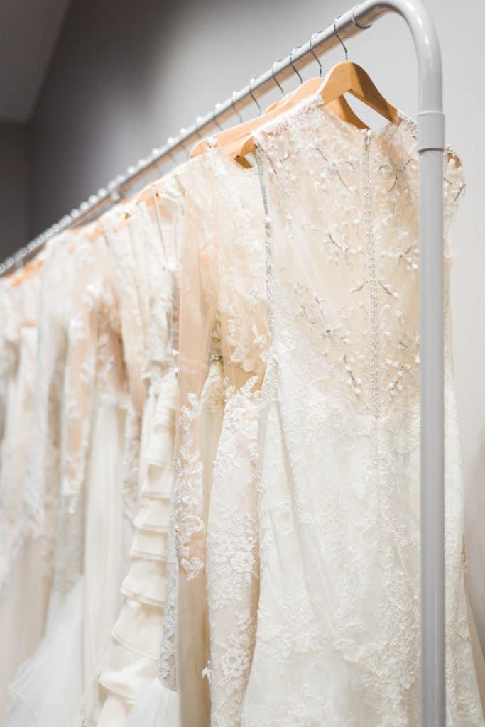 wedding dresses hanging on wardrobe rack