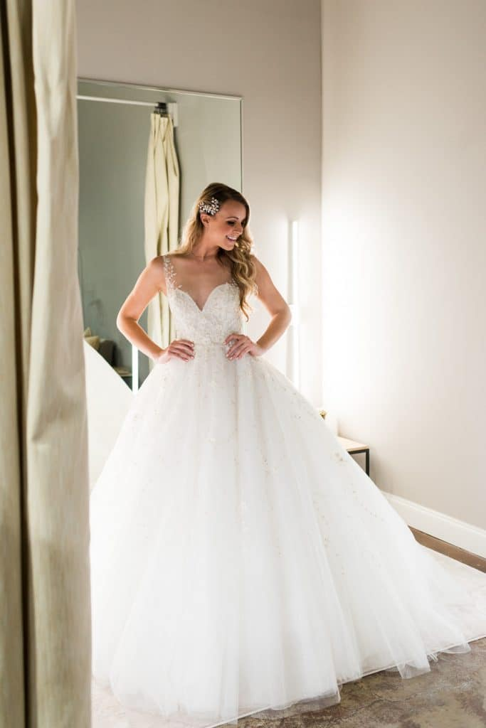 woman trying out ballgown