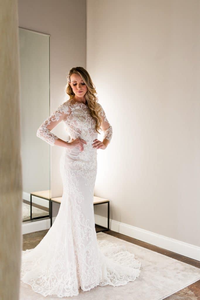 woman in long-sleeved wedding dress