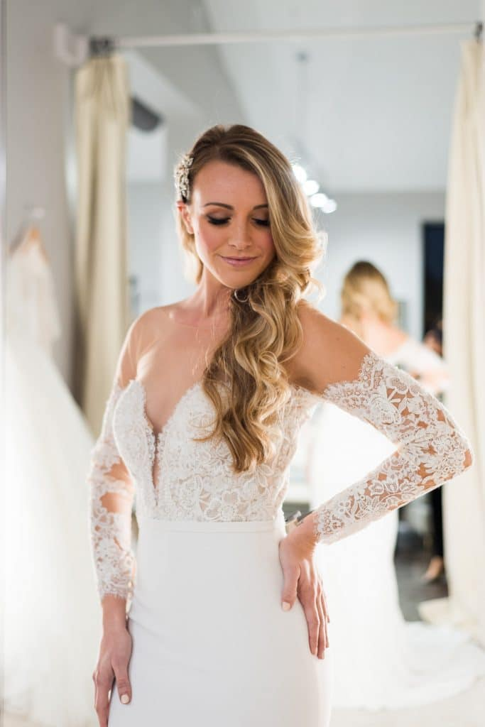 woman in lace-sleeved wedding dress