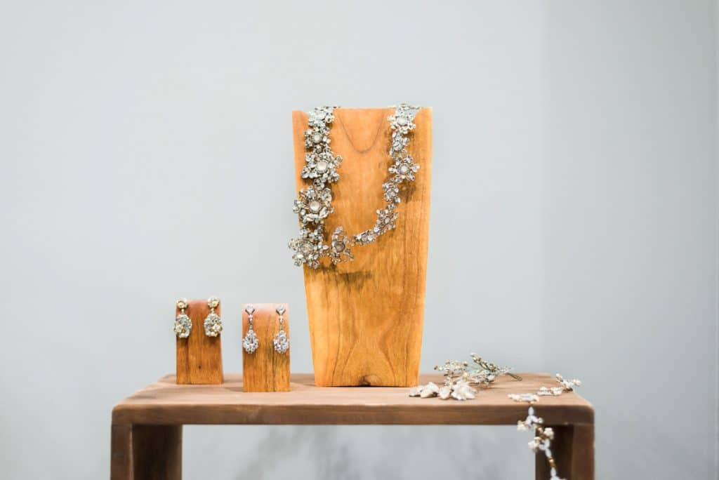 diamond jewelry on rustic wooden display stand