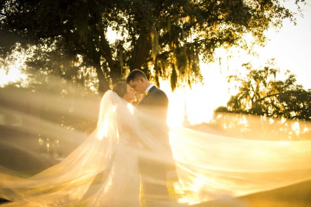 Venue-1902-Bride and groom standing in sunset light