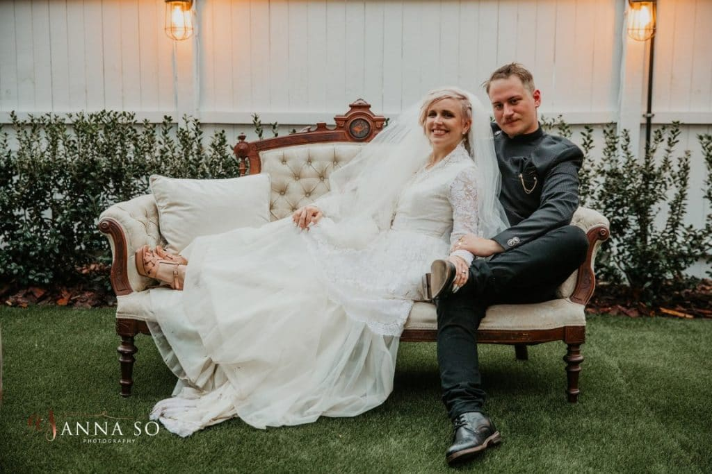 Venue-1902-Happy couple lounging on a couch after wedding