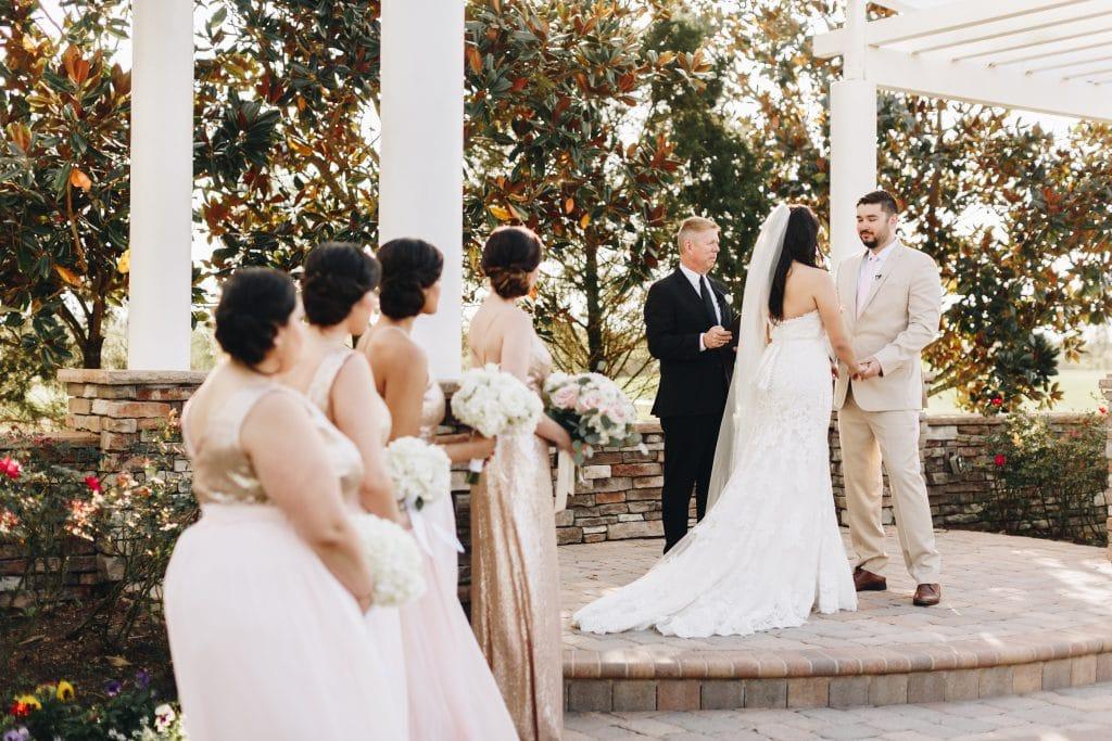 wedding ceremony under outdoor pergola