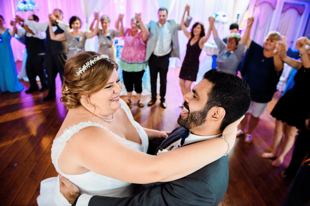 Engaged Sounds Entertainment - bride and groom dancing in middle of circle of guests