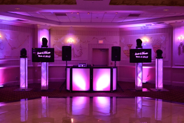 Engaged Sounds Entertainment - DJ equipment set up with pink and purple uplighting