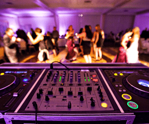 Engaged Sounds Entertainment - DJ soundboard with dance floor in the background