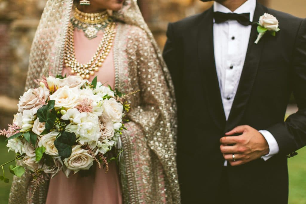 Anna Christine Events - Indian groom in tux and bride with pink and gold sari