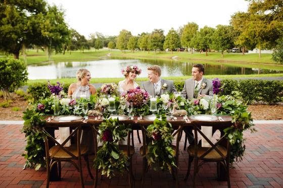 Anna Christine Events - bridal table decorated with gorgeous green and purple floral swag