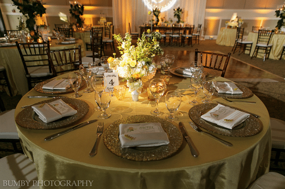 Anna Christine Events - wedding reception table with stunning chargers