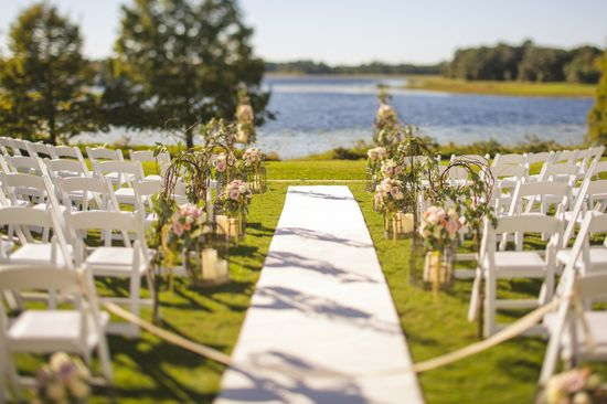 Anna Christine Events - wedding ceremony setup with grapevine and floral candle holders