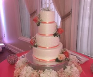 Cake Designers - 4-tiered cake with pink ribbons