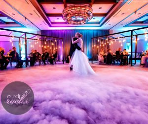Our DJ Rocks - bride and groom dancing on a cloud at reception