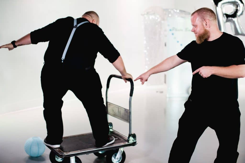 Photobooth Rocks - Man surfing on furniture dolly