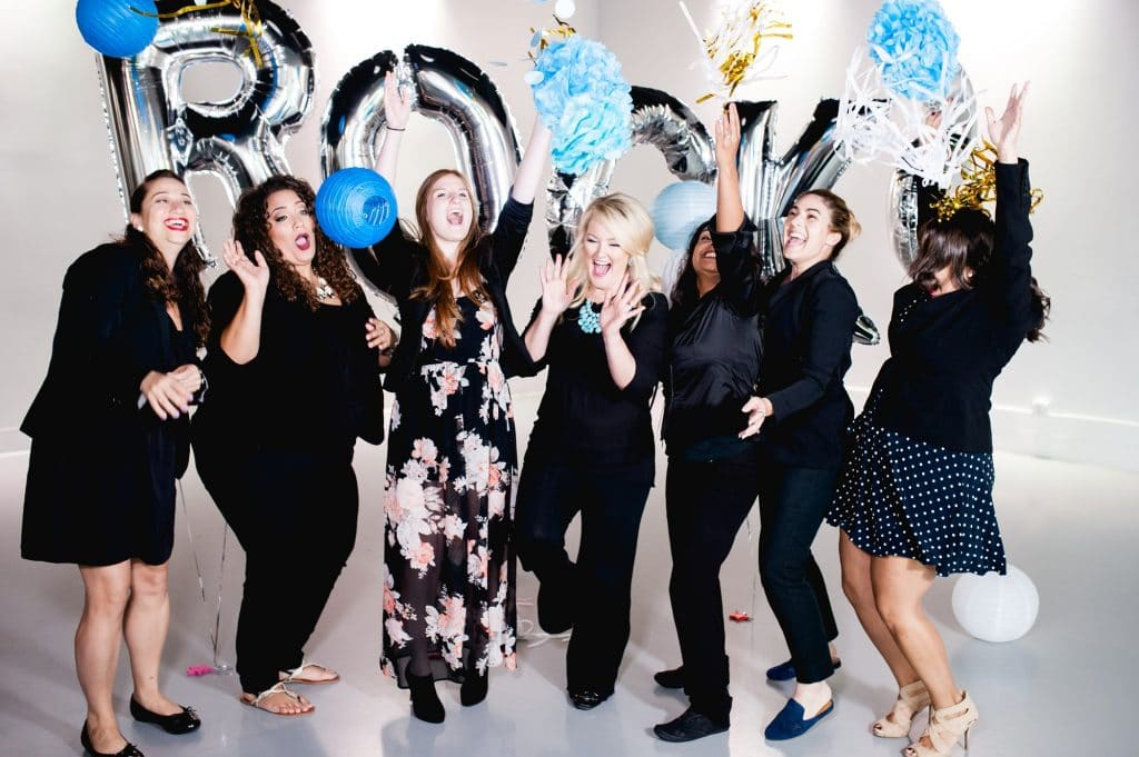 Photobooth Rocks - Owner and attendants celebrating with balloons