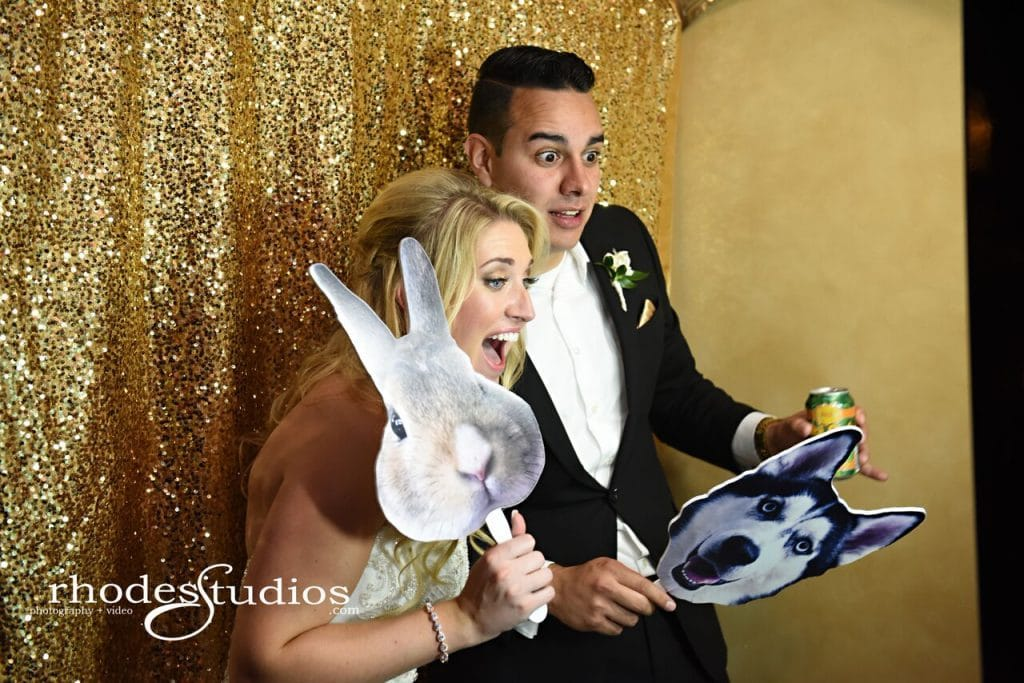 Photobooth Rocks - bride and groom posing with animal cutout masks in photo booth