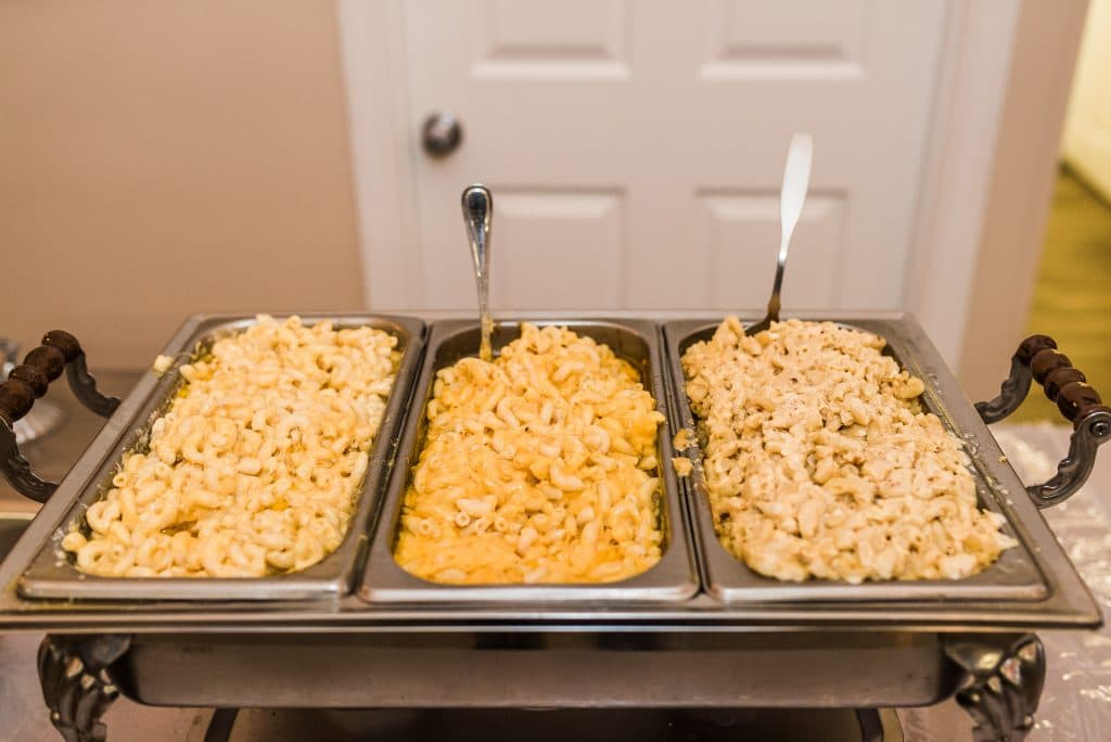 Two Chicks and a Pot - Three chafing dishes filled with macaroni and cheese