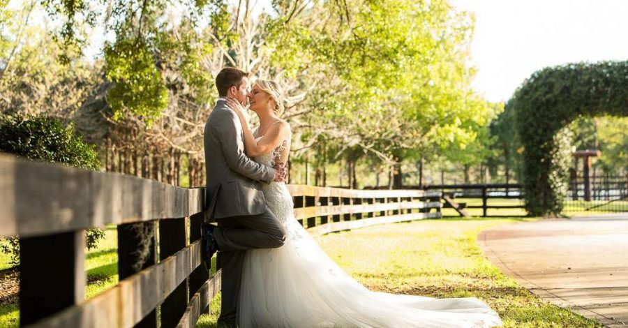 Club Lake Plantation - bride and groom beside fence