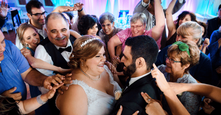Engaged Sounds - bride and groom on dance floor surrounded by guests