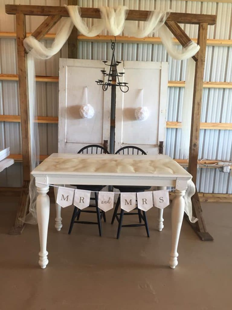 Blue View Event Barn - sweetheart table with rustic furniture and white accents