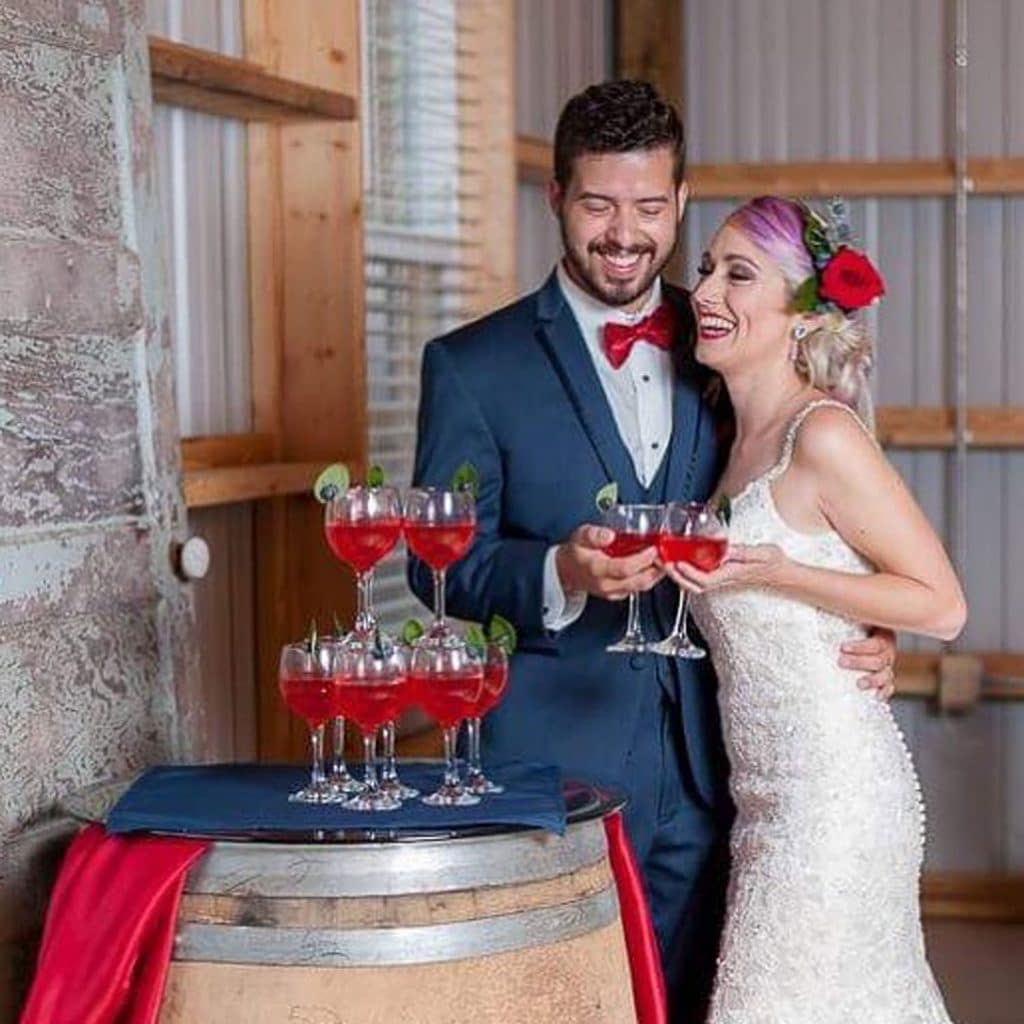 Blue View Event Barn - cute, quirky newlyweds sharing cocktails