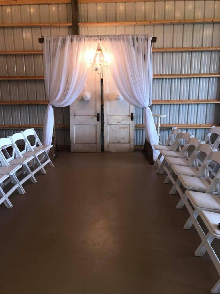 Blue View Event Barn - barn ceremony with gorgeous white drapery