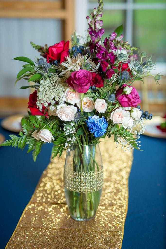 Blue View Event Barn - colorful flower centerpiece