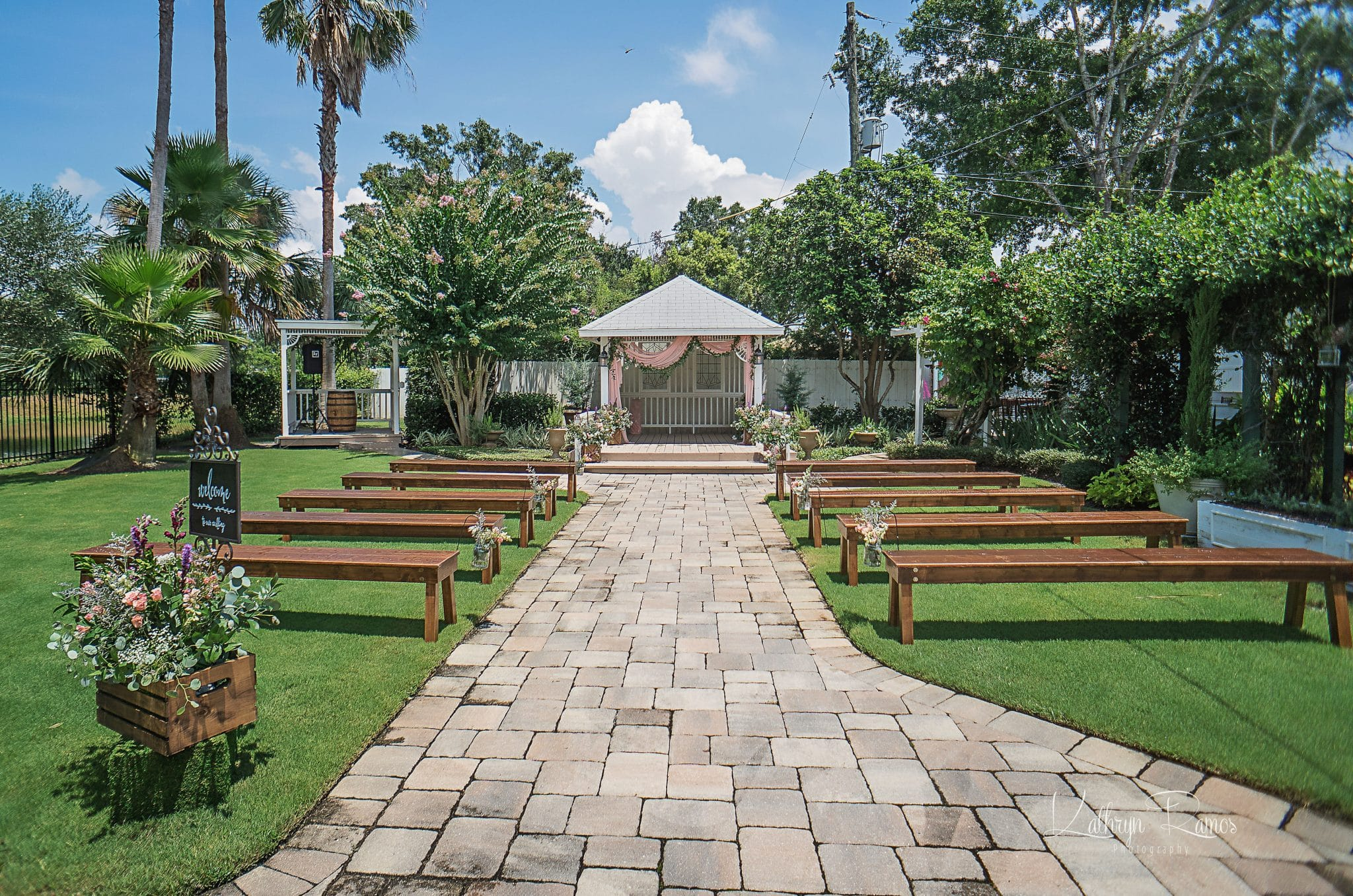 outside ceremony space with benches and brick path