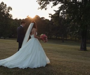 Seltzer Films - bride and groom walking in open field