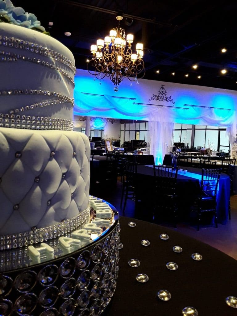 Rhythm and Smooth - quilted wedding cake in foreground of reception hall