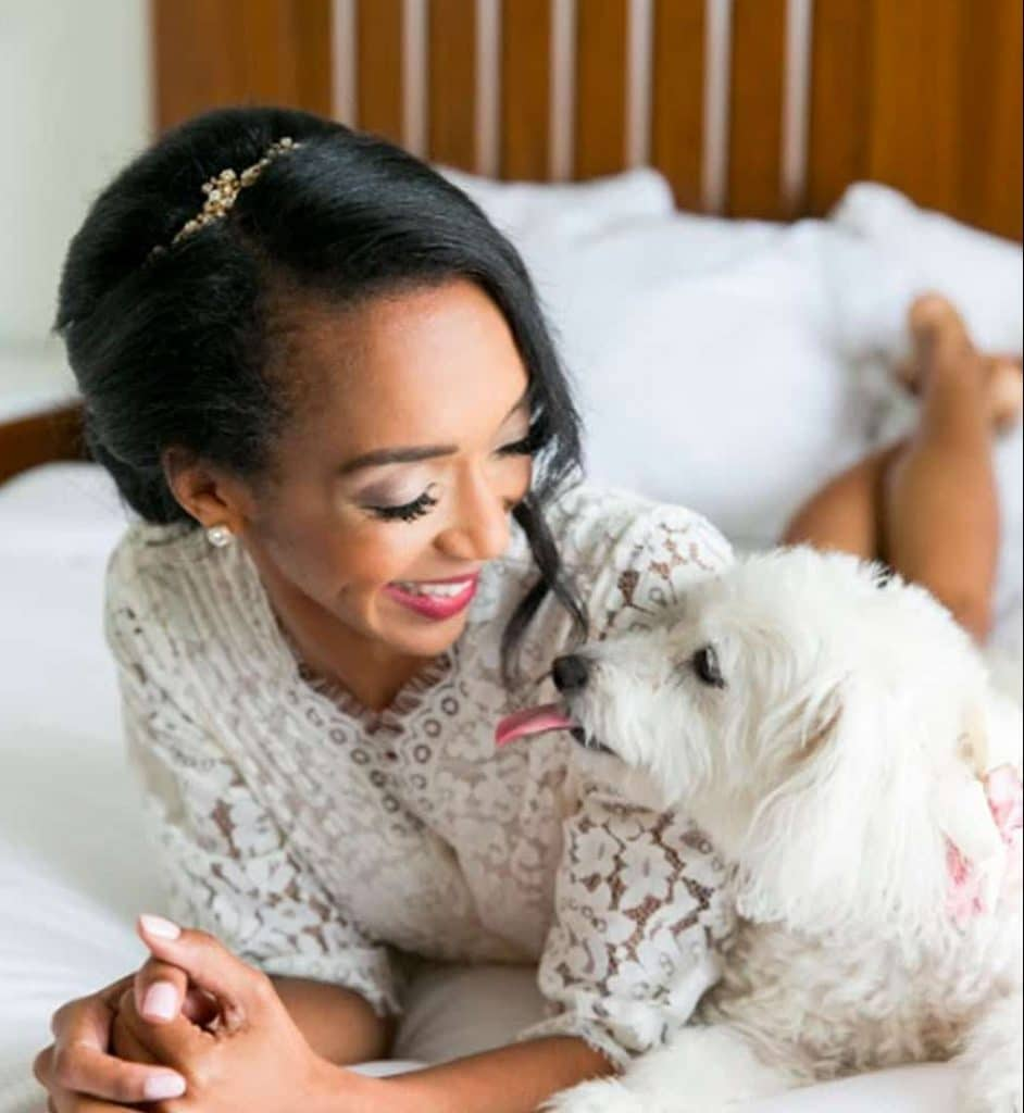 FairyTail Pet Care - bride on bed with dog getting ready