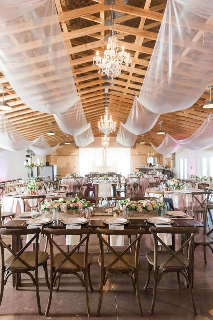 Up the Creek Farms - white canopy accents under wooden rafters