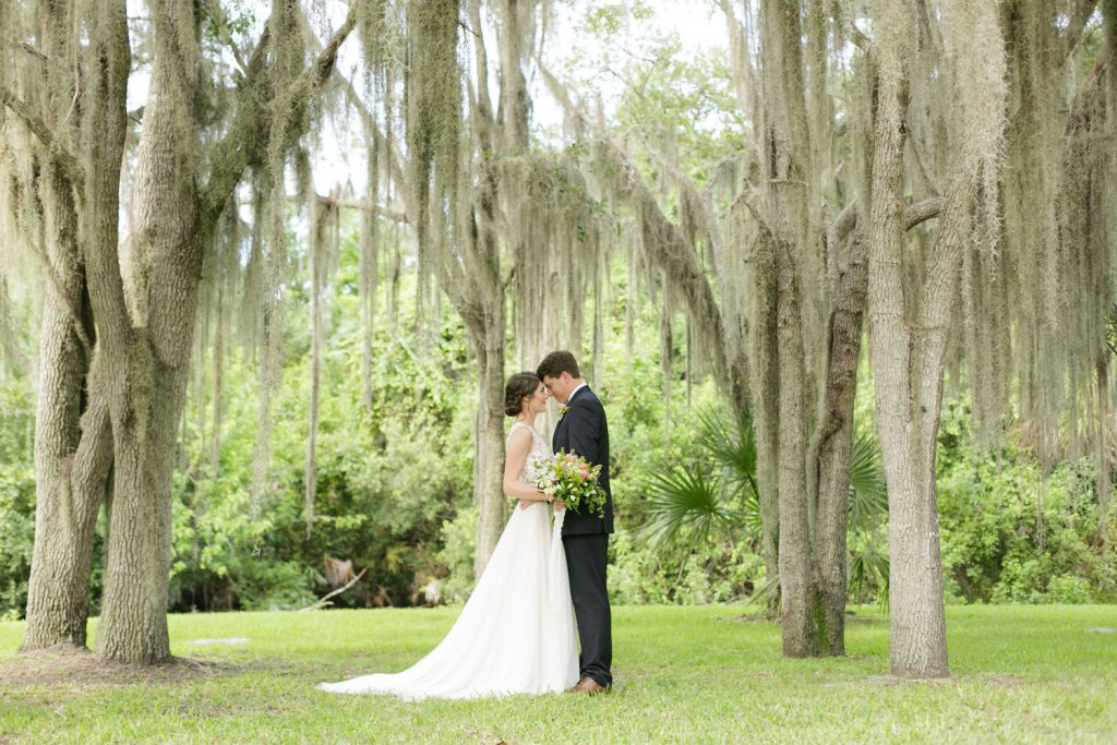 Up the Creek Farms - newlyweds posing under moss-covered trees