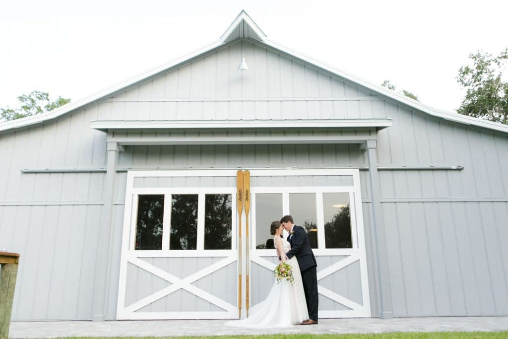 Up the Creek Farms - newlyweds in front of light blue barn