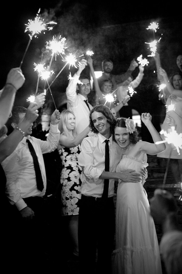 black and white image of newlyweds with sparkler send off