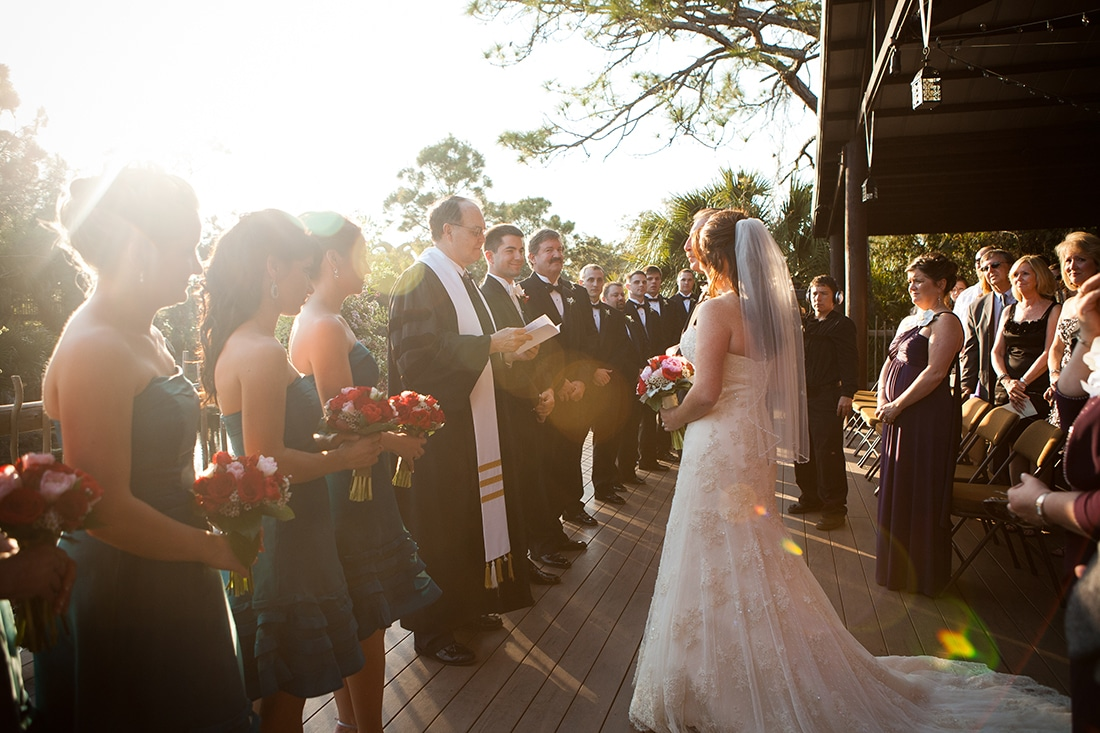 outdoor wedding ceremony with sun glare