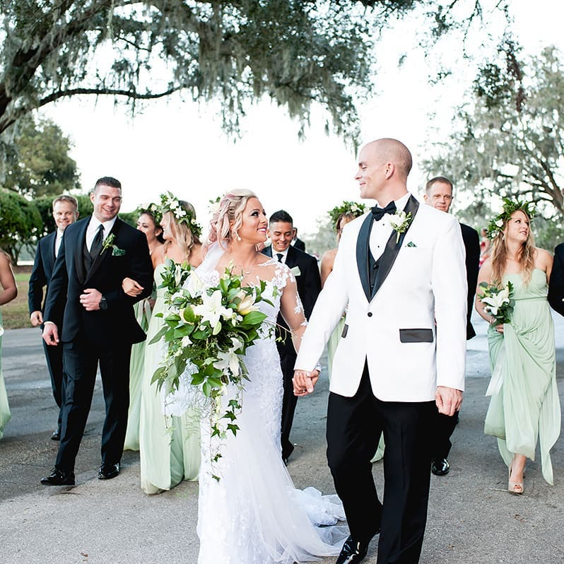 PR Events - entire wedding party walking down a road