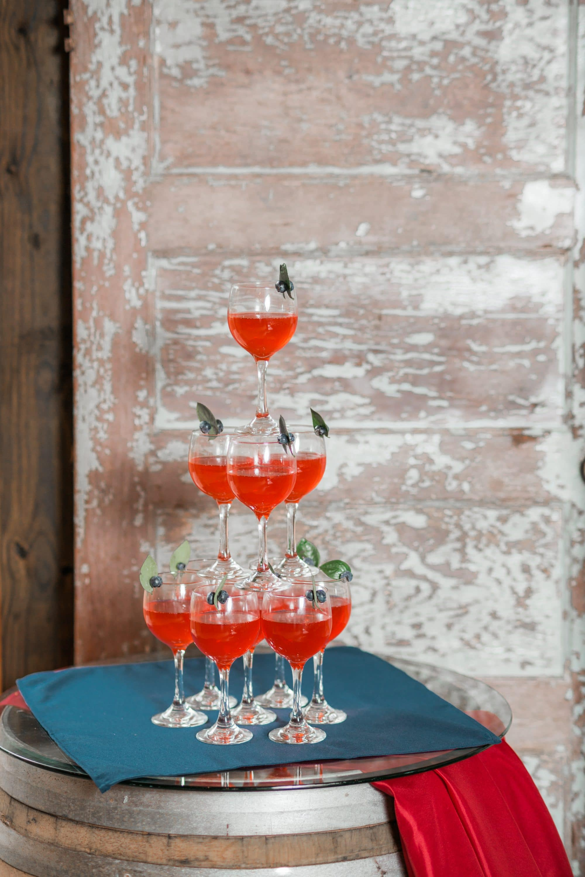 Blue View Event Barn - tower of wine glasses garnished with blueberries