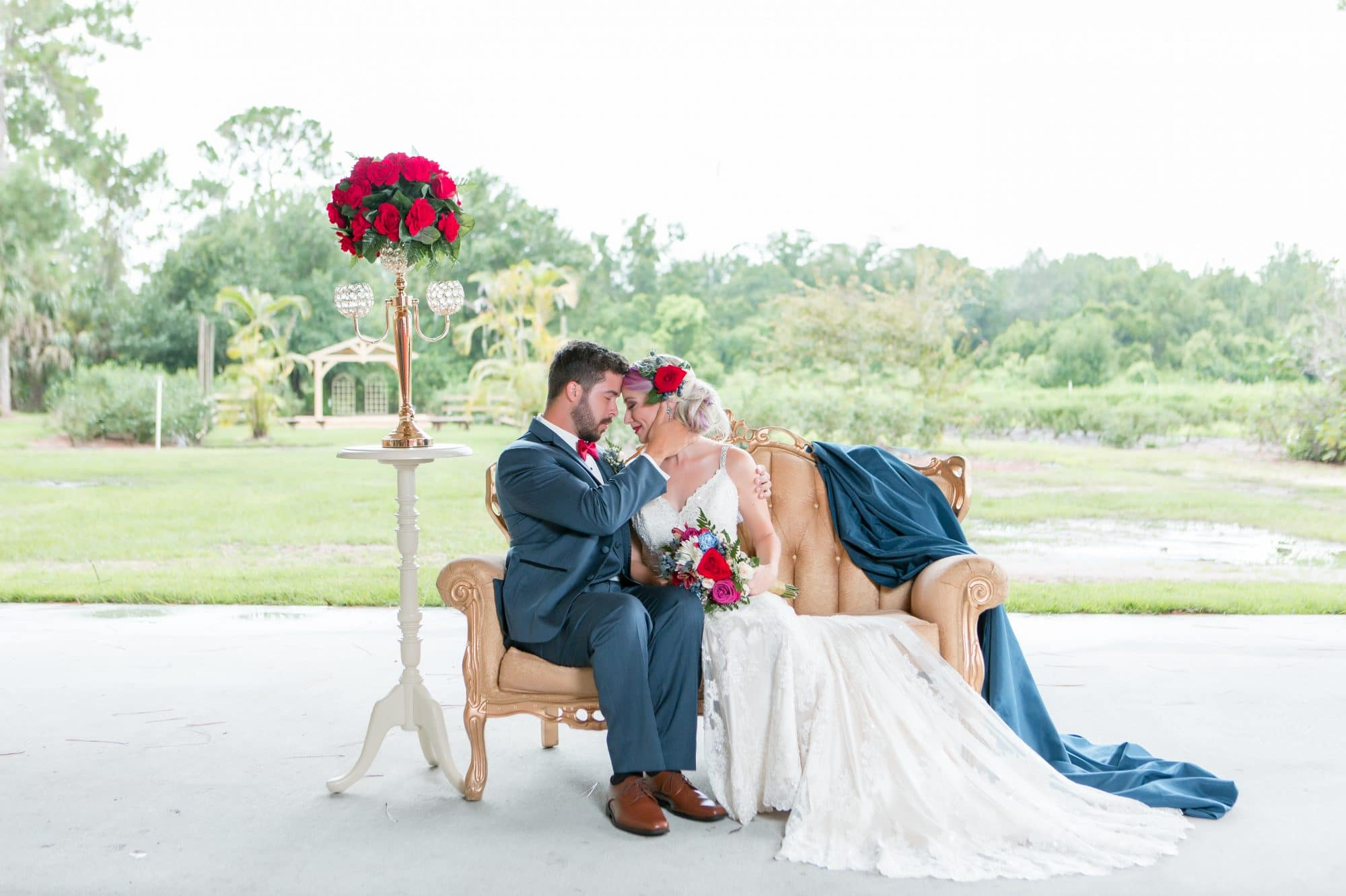 Blue View Event Barn - bride and groom on fancy outdoor couch