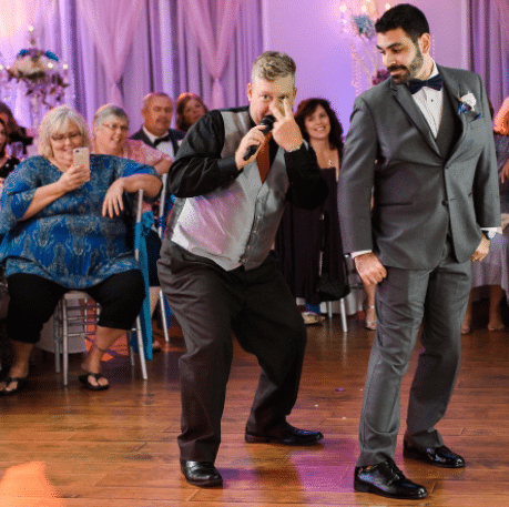 DJ having some fun on the dance floor with the groom