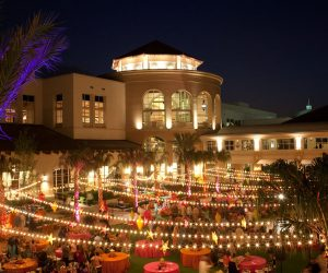 outdoor reception hall in pink and orange with market lighting